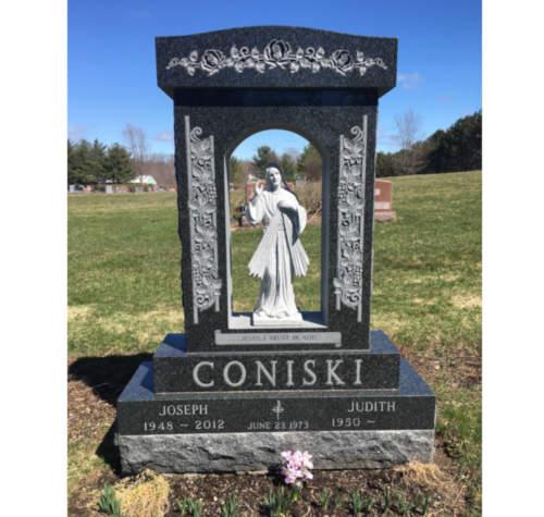 Coniski with statue
