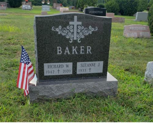 dark granite with cross carving