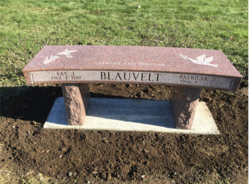 bench in cemetery made of granite