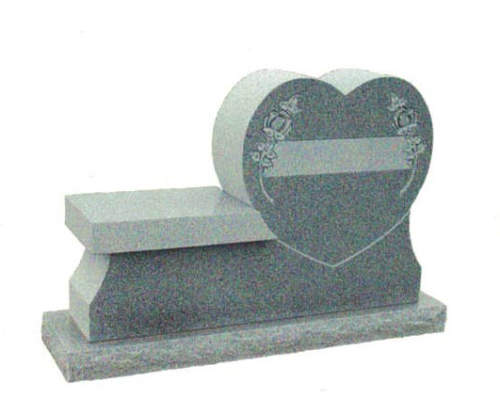gray heart shaped memorial with bench