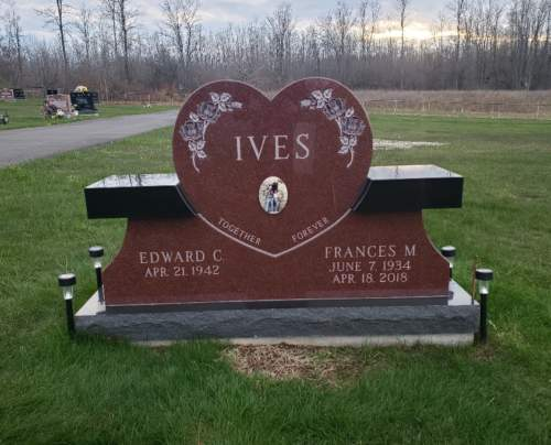 red heart monument with attached black bench seats
